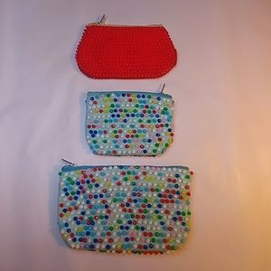 60s, three zip top colorful beaded coin purses.